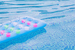 Floating blue and pink air mattress Royalty Free Stock Photography