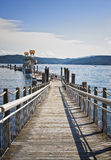 Floating Boardwalk, Coeur D'Alene, Idaho. A boardwalk, said to be the longest floating boardwalk in the world,  runs 3,300 feet on the shores of Lake Coeur D' Royalty Free Stock Images