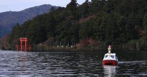 Floating boat at Ashinoko lake in Shizuoka Japan stock footage
