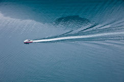 Floating boat on the blue fjord in Norway Stock Images
