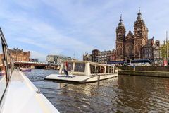 Floating boat on the canal in Amsterdam near city center Stock Images
