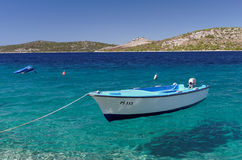 Floating boat on crystal sea Stock Photo