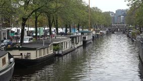 Floating boat-house on channel Prinsengracht near the North market. Amsterdam stock video