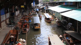 Floating boat market popular tourist attraction in Damnoen Saduak, Thailand stock video