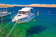 Floating boat on turquoise sea in Velebit channel Royalty Free Stock Photos