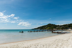Floating boats in the clear blue sea and beautiful summer sky. At Haad Rin, Koh Phangan, Thailand Stock Images