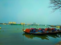 Floating boats in Ganga river stock photography