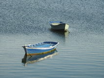 Floating boats. Two boats floating in calm waters Stock Images