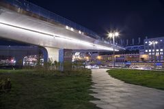 Floating bridge of Zaryadye park at Night on Moskvoretskaya Embankment of Moskva River in Moscow city, Russia. Stock Images