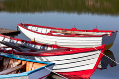 Floating Bright Wooden Boats Royalty Free Stock Photos