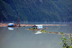 Floating buildings at a logging camp Royalty Free Stock Images