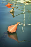 Floating buoy on ropes Royalty Free Stock Photography
