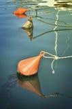 Floating buoy on ropes Royalty Free Stock Photography