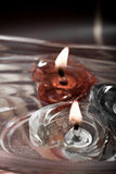 Floating burning candles in glass bowl, retro Royalty Free Stock Photo