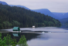 Floating cabin on the lake stock image
