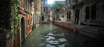 Floating in the Canal`s of the enchanting romantic architecture and waterways of Italy. royalty free stock photography