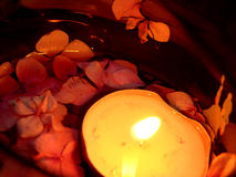Floating Candle. And rose petals Stock Photography