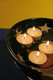 Floating candles. In the star bowle Stock Images