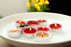 Floating candles. Floating pink candles in white plate Royalty Free Stock Photography