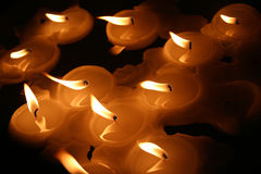 Floating candles. Candles floating on water royalty free stock images