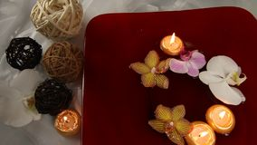 Floating candles and orchids stock video footage