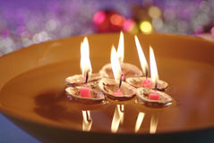 Floating Candles and Paper Boat in Bowl of Water Stock Photos