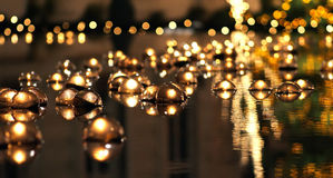 Floating Candles in Reflection Stock Photography