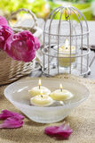 Floating candles in water Stock Image