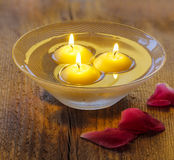 Floating candles in water Stock Images