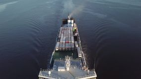 Floating cargo ship. Top view of floating cargo ship