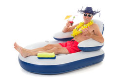 Floating in chair in swimming pool. Senior man relaxing while floating in chair in swimming pool stock photo