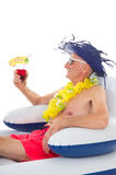 Floating in chair in swimming pool Royalty Free Stock Photography