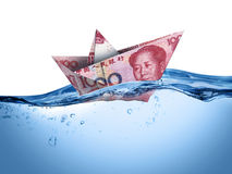 Floating china currency. Paper boat floating on water mean unstable Royalty Free Stock Images