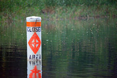 Floating Closed Area to Boating Warning Sign in Lake Water Stock Photo