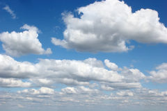 Floating clouds in the sky Royalty Free Stock Image