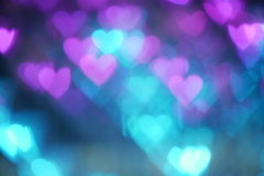 Floating color heart shape bokeh. Color heart shape bokeh background stock images