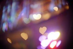Floating color heart shape bokeh. Color heart shape bokeh background stock photo