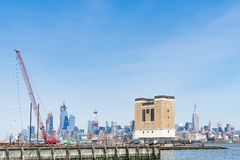 Floating construction crane on Hudson River, Jersey City in the stock photo