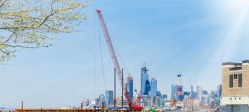 Floating construction crane on Hudson River, Jersey City in the background stock image