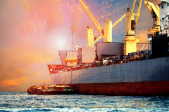 Floating container ship loading rice and food product into stora Royalty Free Stock Image