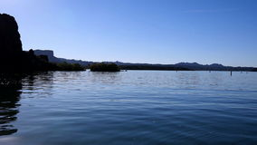 Floating in a cove on calm lake stock footage