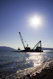 Floating crane. Working in the morning light Stock Photo