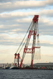 Floating crane. Huge floating cargo crane, at bay Stock Photo