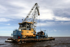 Floating crane. In open sea Royalty Free Stock Photos
