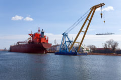 Floating crane. Royalty Free Stock Photos