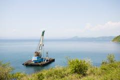 Floating crane Stock Images