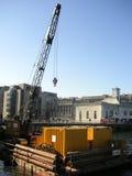 Floating crane. A crane floating in Lake Geneva stock images