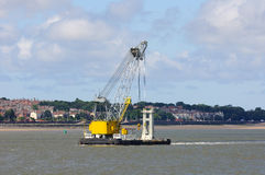Floating crane moving in the waterways of Liverpool Royalty Free Stock Photography