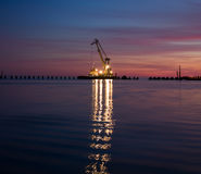 Floating crane at night. Floating crane in the sea at the night Royalty Free Stock Photos