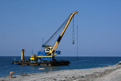 The floating crane on the seacoast Stock Photography